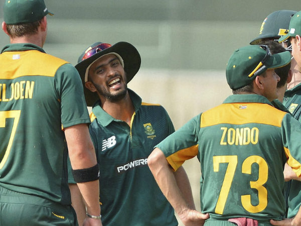 Mandeep Singh (second left) is seen on the field in a South African jersey with his 'team-mates'