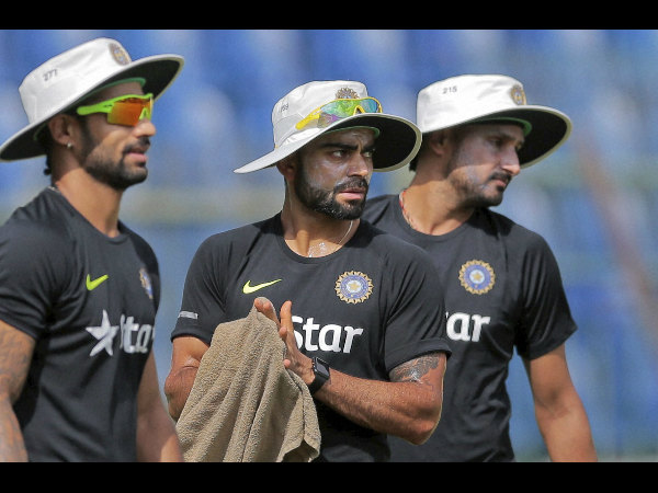 From left: Shikhar Dhawan, Virat Kohli and Harbhajan Singh during a practice session in Sri Lanka