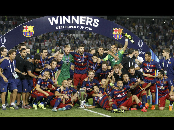 Barcelona players celebrate with the trophy after winning the UEFA Super Cup