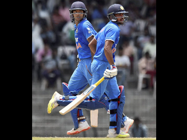 Mayank and Manish run between the wickets during their 203-run partnership