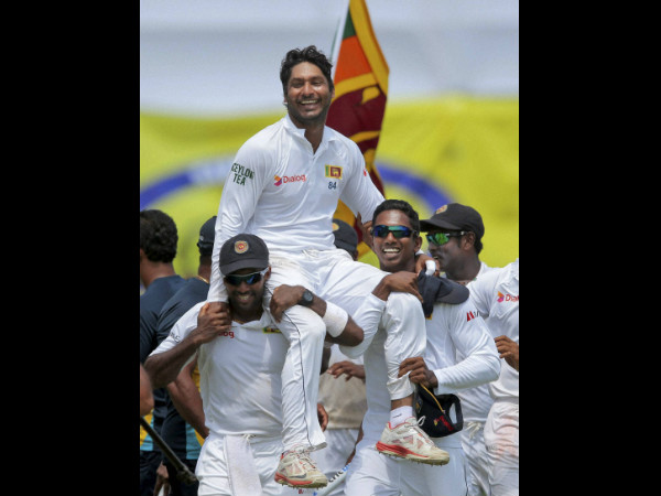 Sri Lankan team members carry Kumar Sangakkara on their shoulders as they walk around the field to celebrate their win