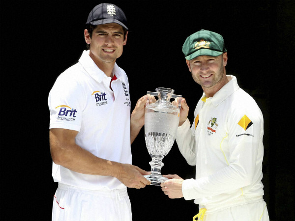 File photo: Cook (left) and Clarke with the Ashes trophy