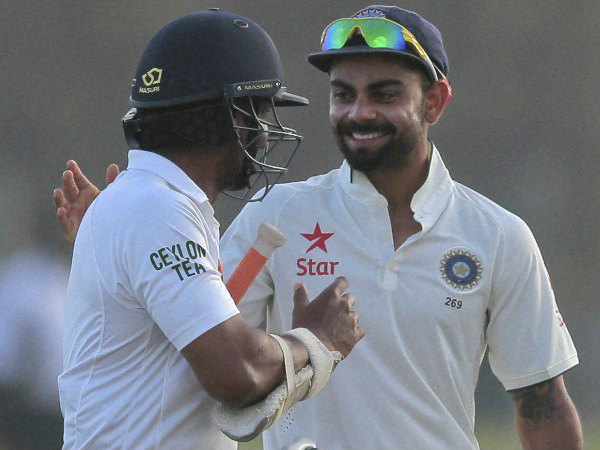 Kohli (right) and Sangakkara during the 1st Test in Galle