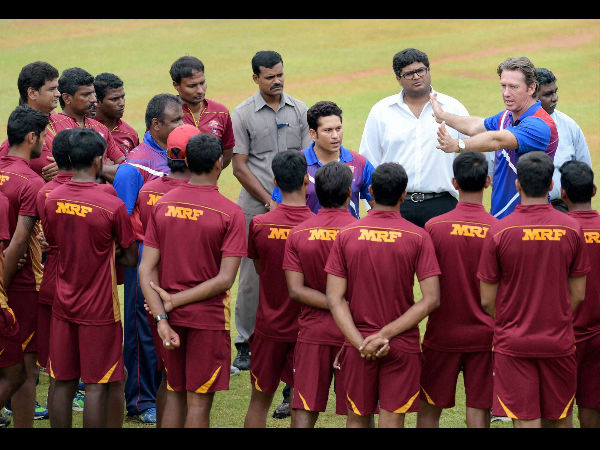Cricket legends Sachin Tendulkar and Glenn McGrath (right) interacting with young cricketers at MRF Pace Foundation in Chennai on Friday.