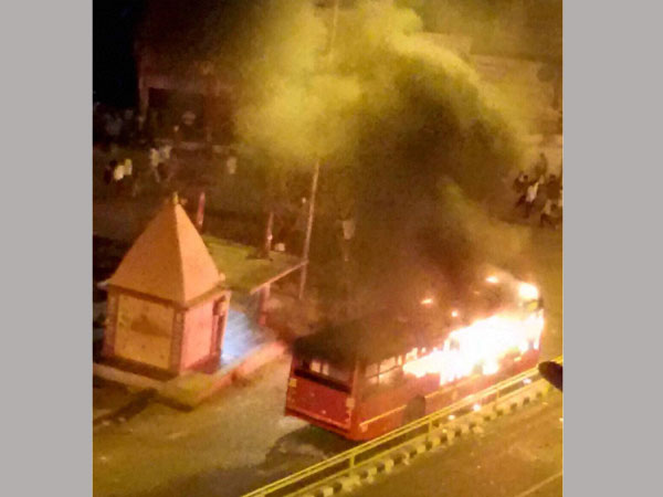 Violence in Gujarat: Buses set on fire