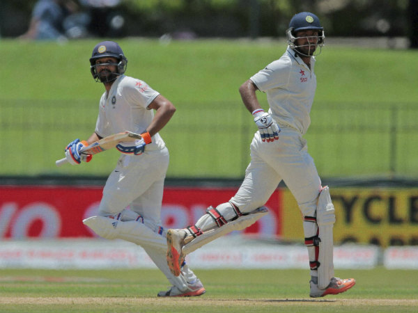 Rohit (left) and Pujara run between the wickets on the 2nd day