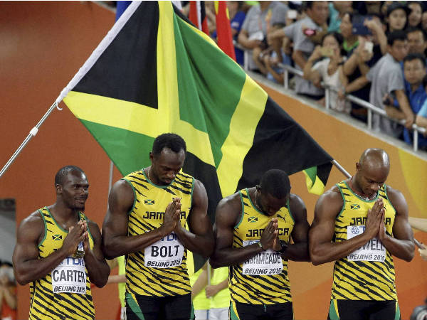 The Jamaican team bows as they enter the arena prior to winning the gold medal in the 4x100m relay