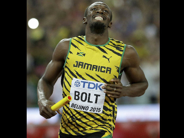 Usain Bolt smiles after anchoring their men's 4x100m relay team to victory