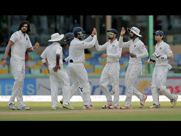 Indian players celebrate the dismissal of Upul Tharanga off the bowling of Ishant Sharma (left)