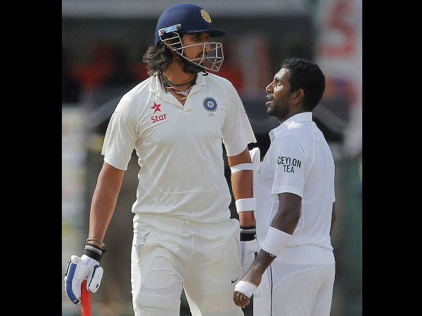 Ishant (left) and Dhammika have a go at each other