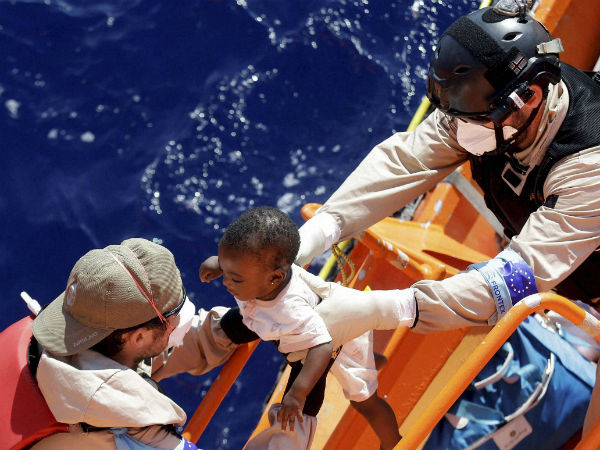 A baby is helped to board on the Norwegian Siem Pilot ship