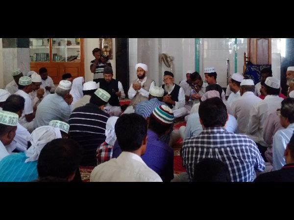 A view of the mosque with Jamaat representatives offering prayers