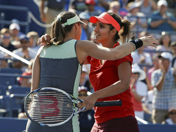 Martina (left) and Sania celebrate after winning their 4th round match at US Open on Sunday (September 6)