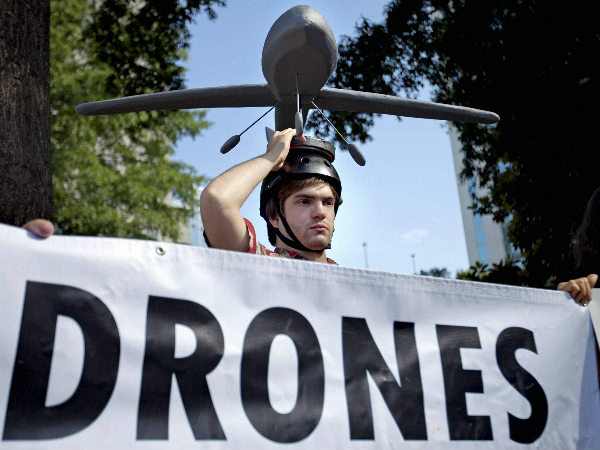 File photo: Adan Wadley, of Dunwoody, Georgia, wears a drone hat as he protests against the use of drones
