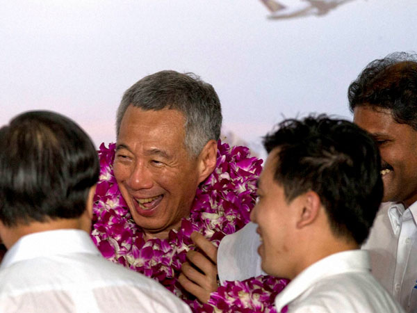 Singapore's Prime Minister Lee Hsien Loong of the ruling People's Action Party celebrates a win in his constituency in Singapore.