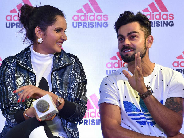 Virat Kohli (right) and Sania Mirza share a light moment during the launch of Adidas showroom in Bengaluru on Saturday.