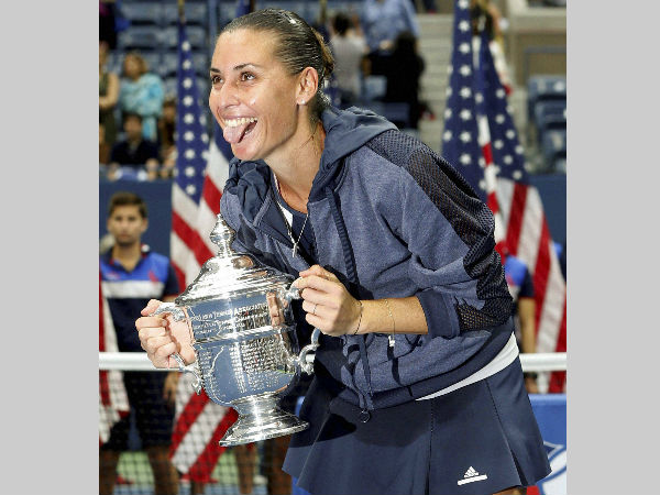 Flavia Pennetta, of Italy, reacts as she poses with her US Open trophy