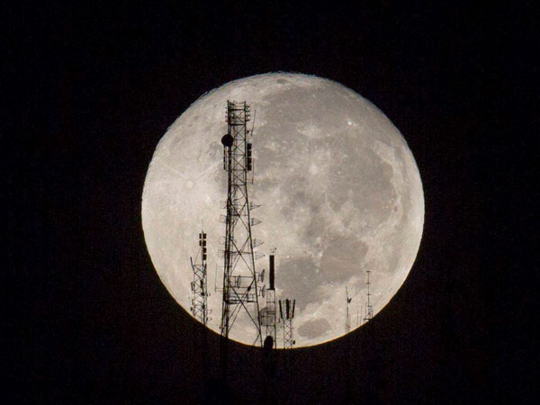 Port-au-Prince : A full moon silhouettes television and radio antennas on Boutilier Mountain, in Port-au-Prince, Haiti, Sunday Sept. 27, 2015. The full moon was seen prior to a phenomenon called a Super Moon eclipse that will occur on Monday, Sept. 28.