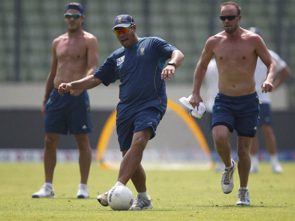 Russell Domingo, centre, plays a game of soccer with Faf du Plessis, left, and AB de Villiers in Dhaka in this file photo