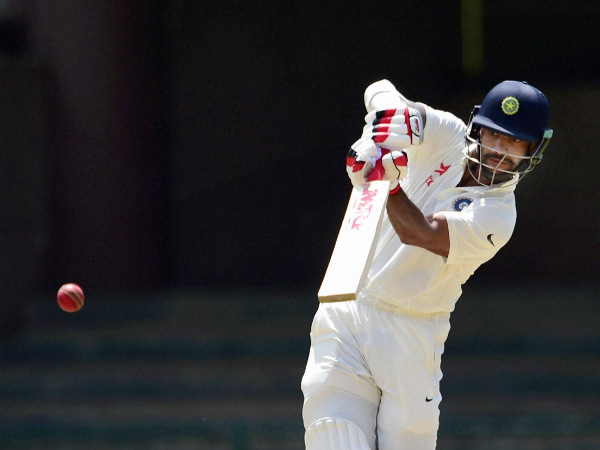 Shikhar Dhawan plays a shot on way to 150