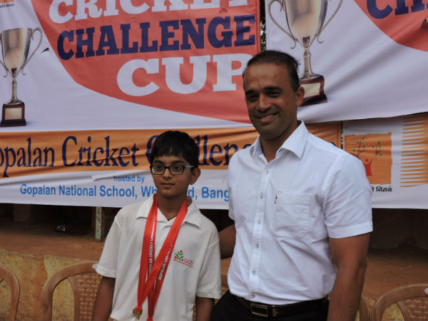 Samit Dravid (left) poses with his medals