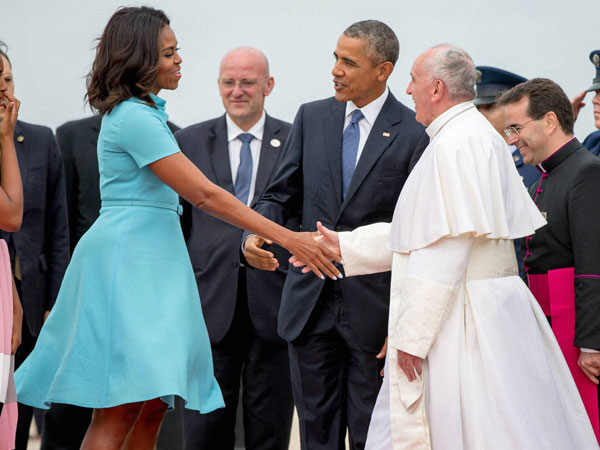 First lady Michelle Obama, accompanied by President Barack Obama, greet Pope Francis upon his arrival at Andrews Air Force Base