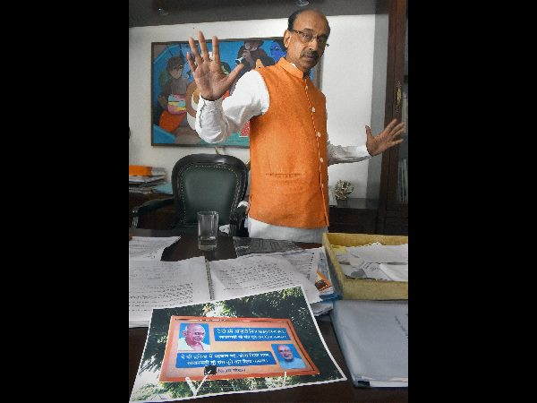 BJP leader Vijay Goel talking to the media at his residence about his poster on Prime Minister Narendra Modi, in New Delhi on Thursday.
