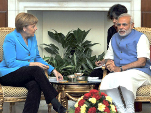 Modi with Merkel in a meeting in New Delhi