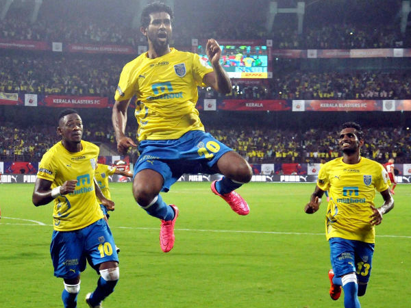 Kerala Blasters FC players celebrate after scoring a goal during their Indian Super League (ISL) match against North East United FC in Kochi on Tuesday.