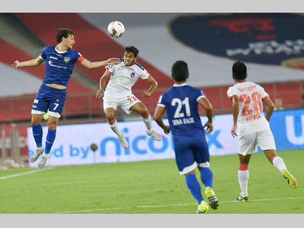 Delhi Dynamos FC and Chennaiyin FC (blue jersey) players in action during the ISL match at Jawaharlal Nehru Stadium in New Delhi on Thursday