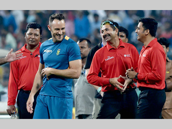 South African captain Faf du Plessis (2nd left) shares a light moment with umpires during ground inspection