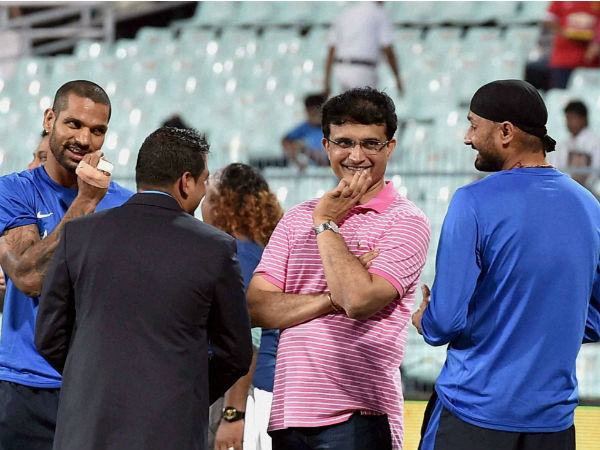 Sourav Ganguly (2nd right), Shikhar Dhawan (left) and Harbhajan Singh before the start of T20 match at Eden Gardens