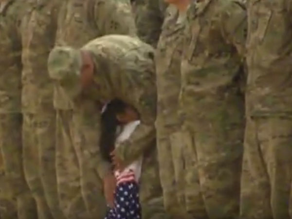 Little girl hugs father