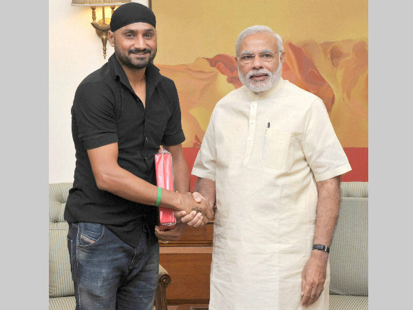 Prime Minister Narendra Modi with Harbhajan Singh in New Delhi on Saturday.