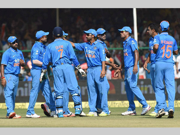 Indian players celebrate a wicket during the 1st ODI against South Africa in Kanpur