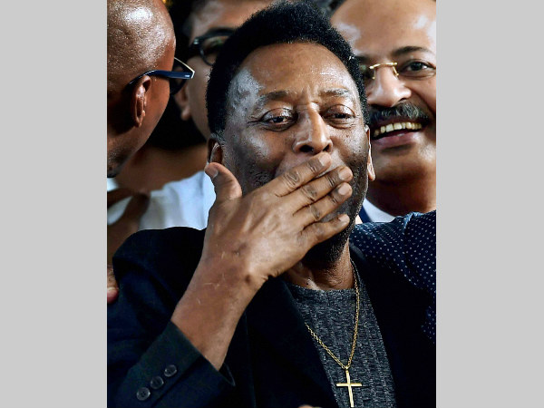Pele gestures to his fans after arriving in Kolkata on Sunday (October 11)