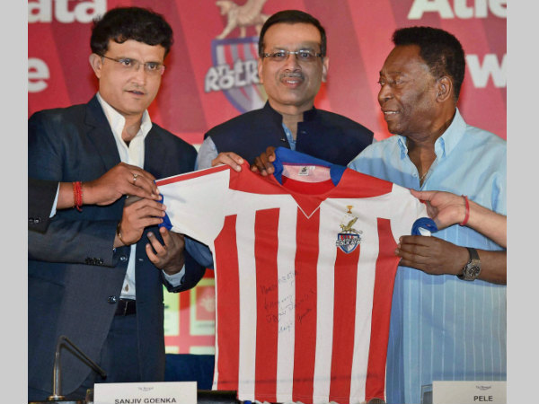 Pele (right) is presented a Atletico de Kolkata jersey by Sourav Ganguly (left) and Sanjiv Goenka in Kolkata on Monday