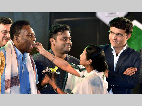 West Bengal CM Mamata Banerjee feeds a piece of cake to Pele with Sourav Ganguly and AR Rahman at a function in Kolkata on Monday evening