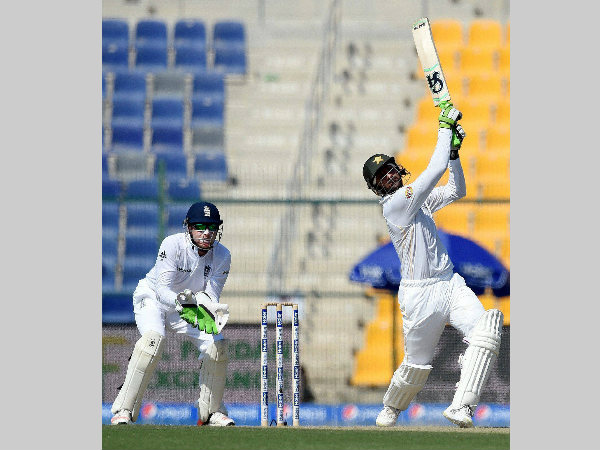 Shoaib Malik plays a shot on way to his century in Abu Dhabi