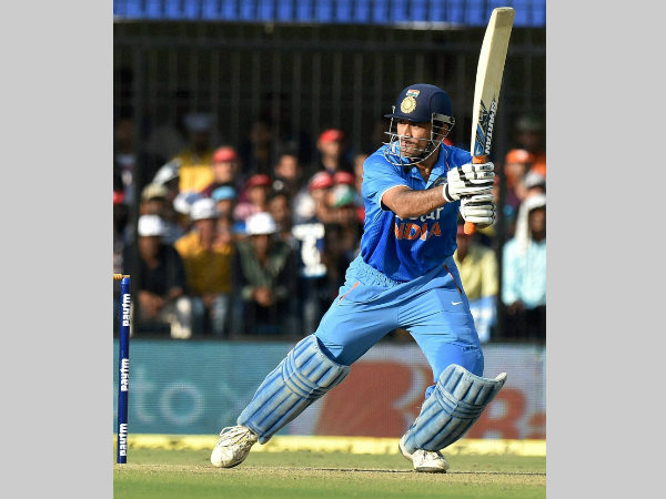 Dhoni plays a shot on way to 92 not out