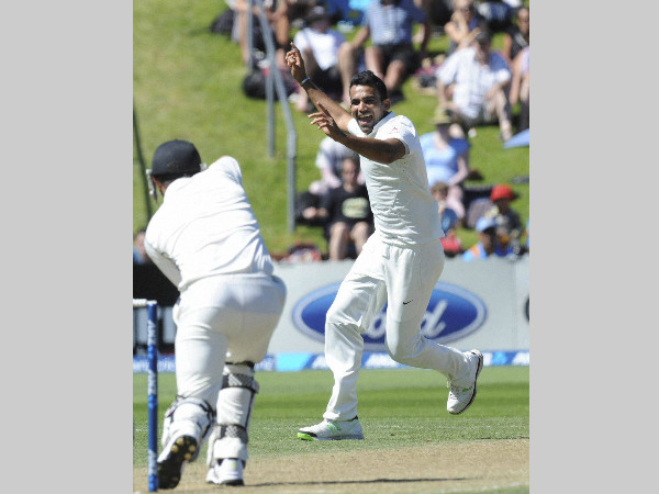 Zaheer Khan, right, celebrates after dismissing New Zealand's Hamish Rutherford caught by wicketkeeper MS Dhoni on the 3rd day of the 2nd Test at Basin Reserve, in Wellington, New Zealand, on February 16, 2014. This was Zaheer's last Test for India