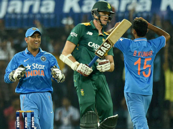 Dhoni (left) and Bhuvneshwar (right) celebrate the dismissal of Morne Morkel (centre), South Africa's last wicket, in Indore