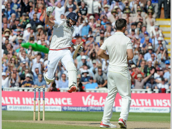 File photo: Joe Root (left) celebrates after England beat Australia in a Test in July this year. Also seen is Mitchell Johnson (right) of Australia