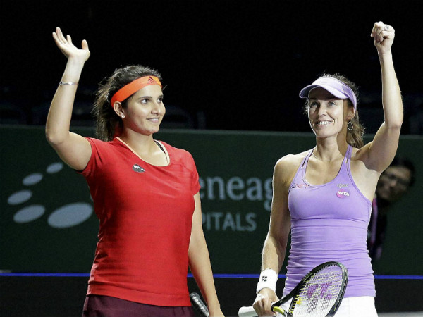 Sania, left, and Martina celebrate after they defeated Raquel Kops-Jones and Abigail Spears