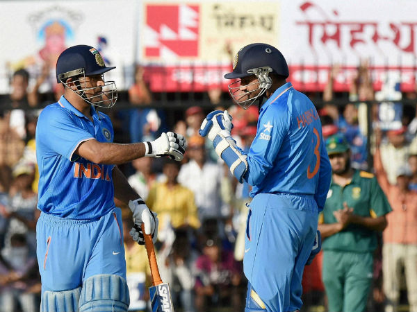 Dhoni (left) celebrates his half century with Harbhajan during 2nd ODI in Indore on October 14