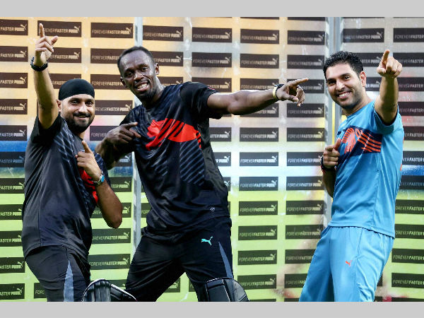 Yuvraj (right) and Harbhajan (left) with Olympic champion sprinter Usain Bolt of Jamaica in this September, 2014 file photo taken in Bengaluru