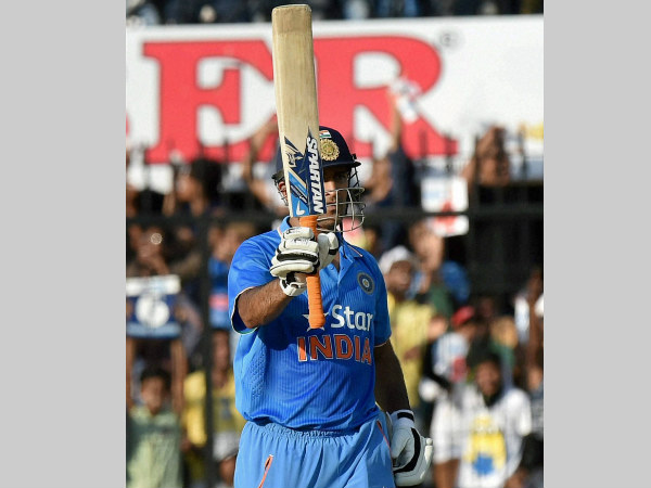 Dhoni celebrates his half century against South Africa in Indore