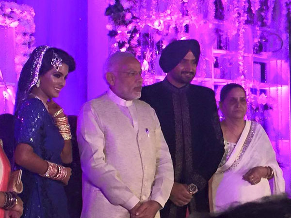Narendra Modi with Harbhajan and Geeta