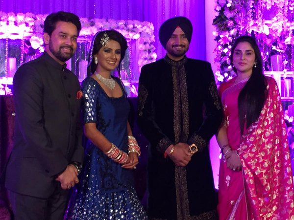 Anurag Thakur and wife with Bhajji and Geeta