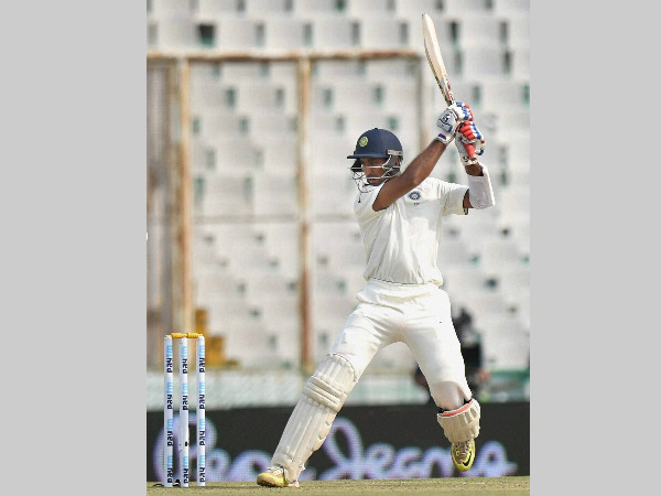 Pujara plays a shot